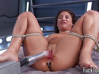 Restrained babe pussy toyed by dildo machine